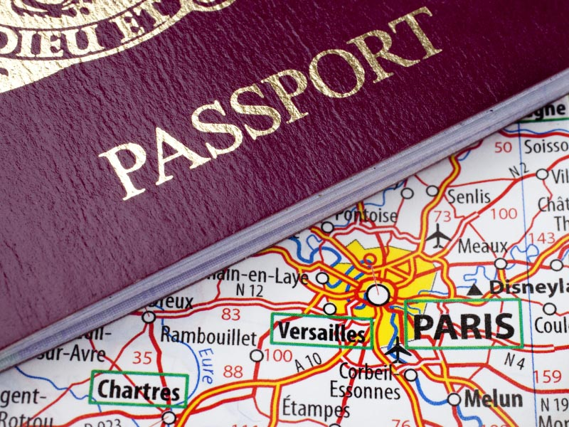 Passport and Paris Map