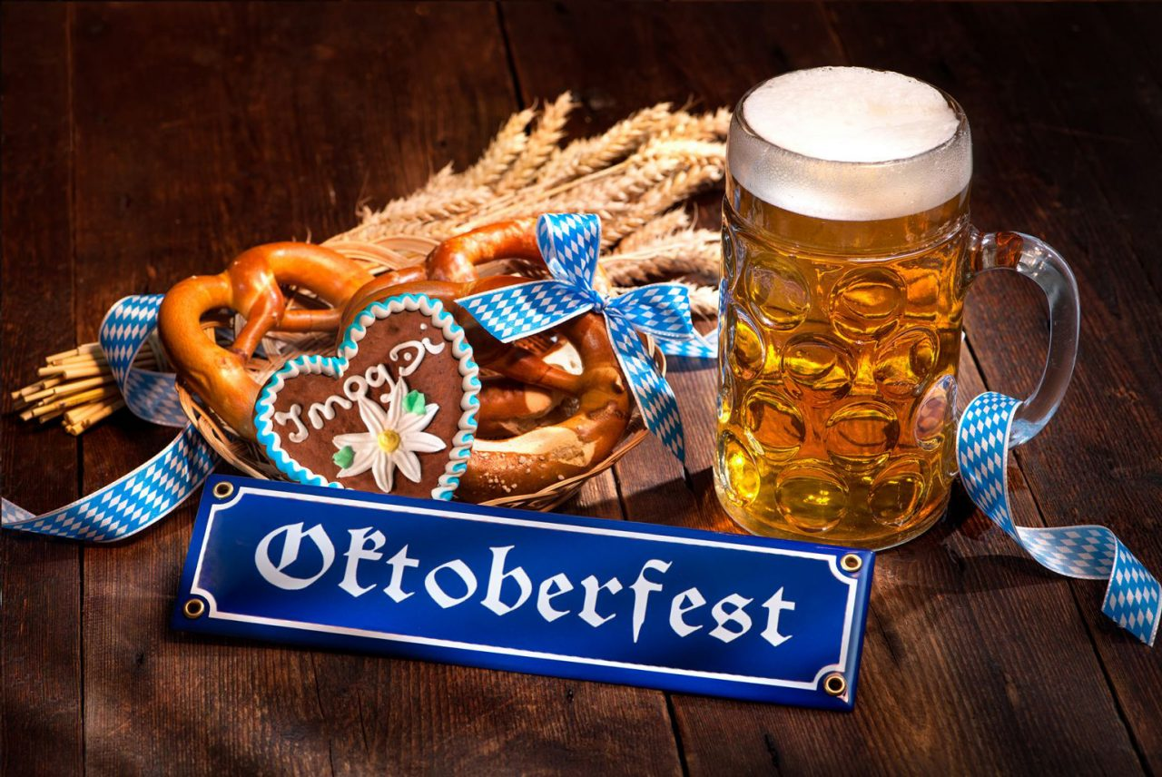 stock-photo-original-bavarian-pretzels-with-beer-stein-on-wooden-board-oktoberfest-background-4040006-1280x856.jpg